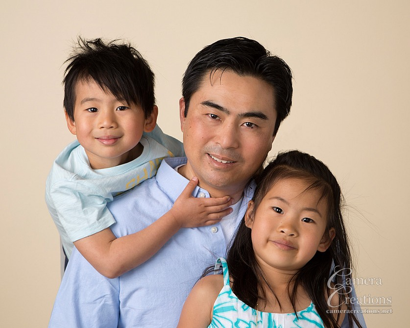 Father, son and daughter at family portrait session at Camera Creations LLC studio in Los Angeles.