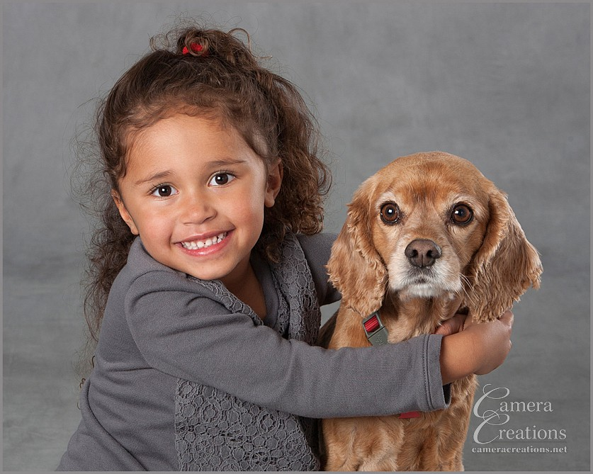 Family portrait photography with little girl and her dog at Camera Creations LLC studio in Los Angeles.