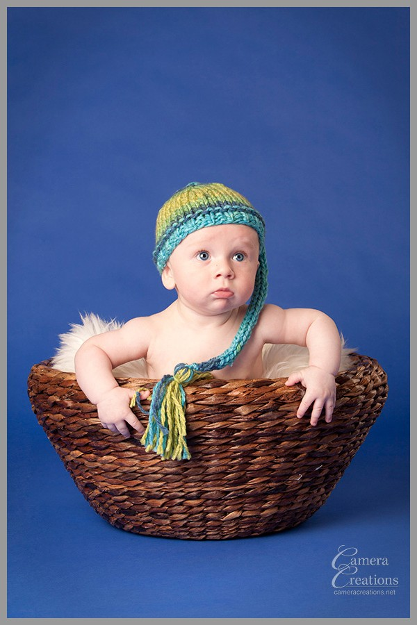 Baby portrait in a basket at Camera Creations LLC studio  in Los Angeles.