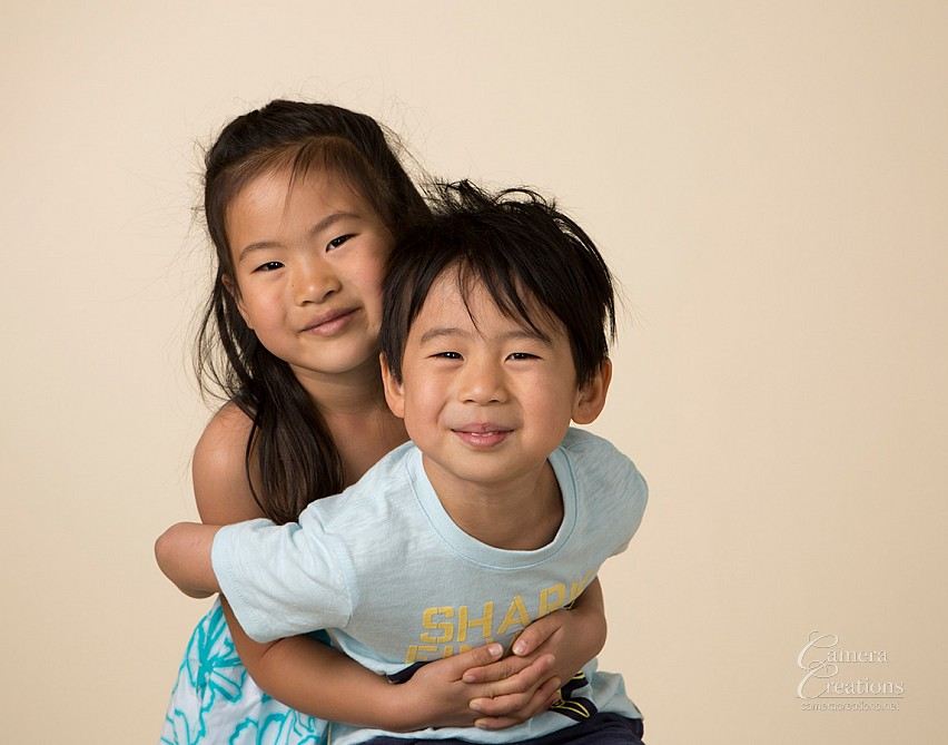 Sister and brother at family portrait session at Camera Creations LLC studio in Los Angeles.
