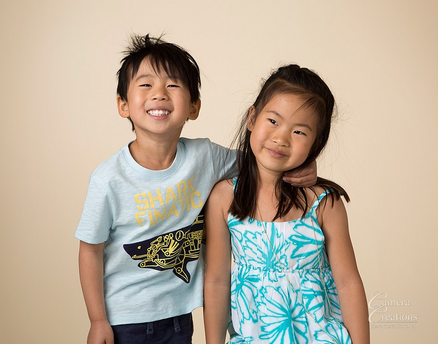 Brother and sister at family portrait session at Camera Creations LLC studio in Los Angeles.