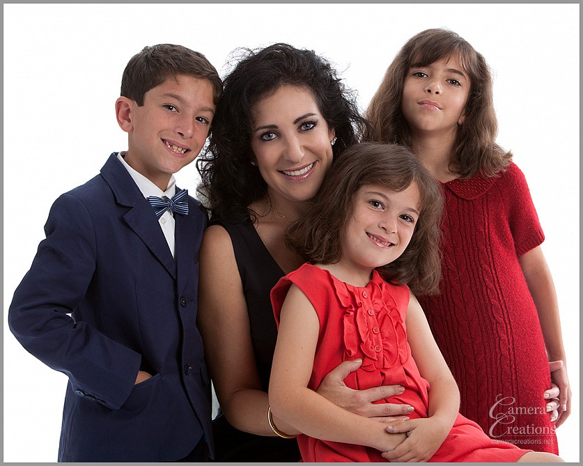 Family portrait photography session at Camera Creations LLC studio in Los Angeles. Mother with son and two daughters.