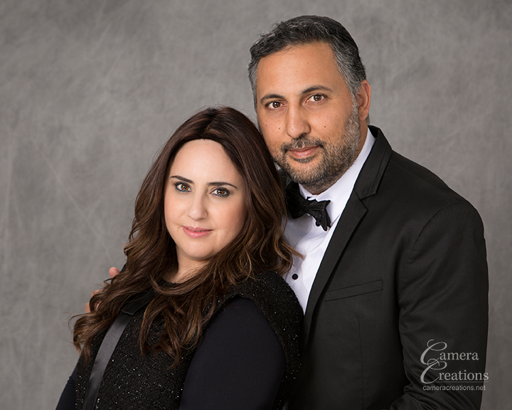 Husband and wife at family portrait session at Camera Creations Photography portrait studio in Los Angeles.