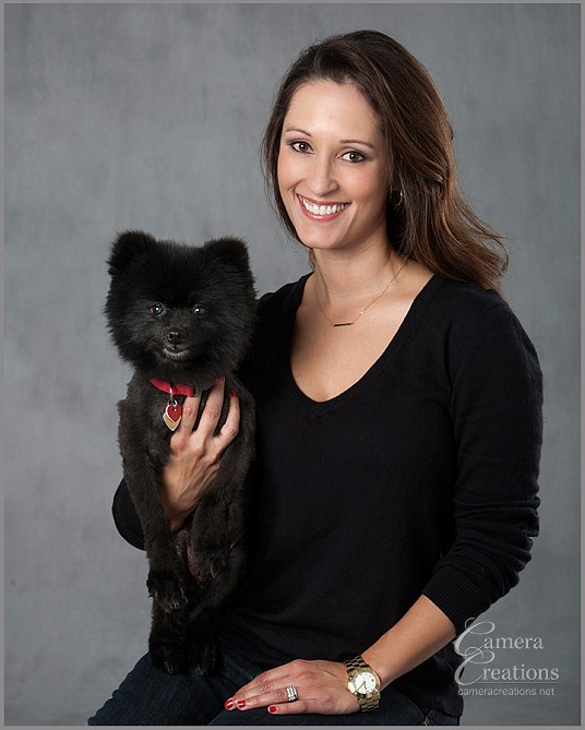 Portrait of daughter with her Pomeranian dog at family portrait session.