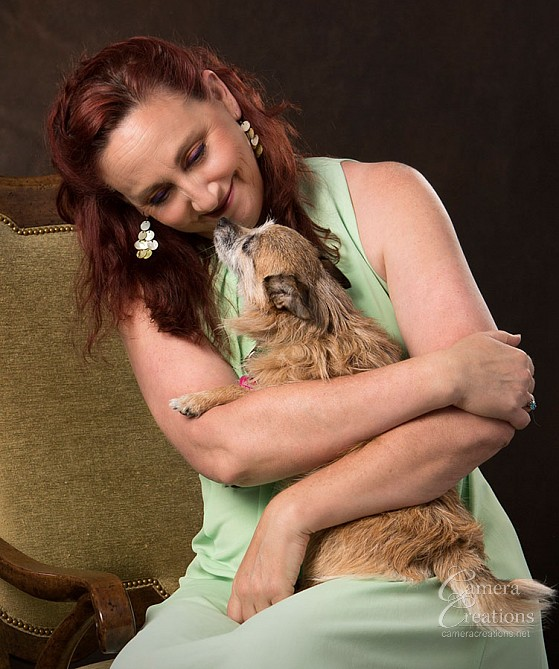 Portrait of Lisette Morris and her dog Brown at Camera Creations Photography studio.
