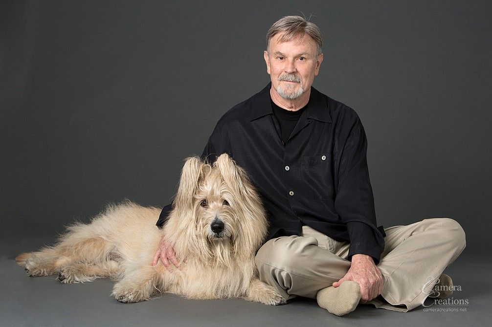 Dog and his master at pet portrait session in Camera Creations portrait studio, Los Angeles.